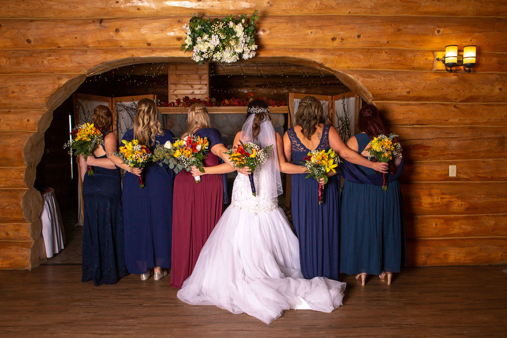 Glenhaven winter Minnesota wedding rustic barn, orange and yellow bouquet, bridesmaids in navy