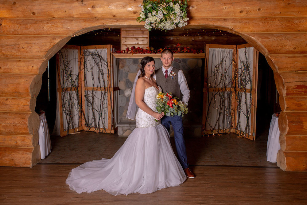 Glenhaven winter Minnesota wedding rustic barn, orange and yellow bouquet
