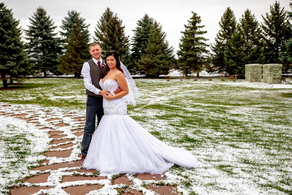 Glenhaven winter Minnesota wedding rustic barn, orange and yellow bouquet, outdoor photos with snow on the ground
