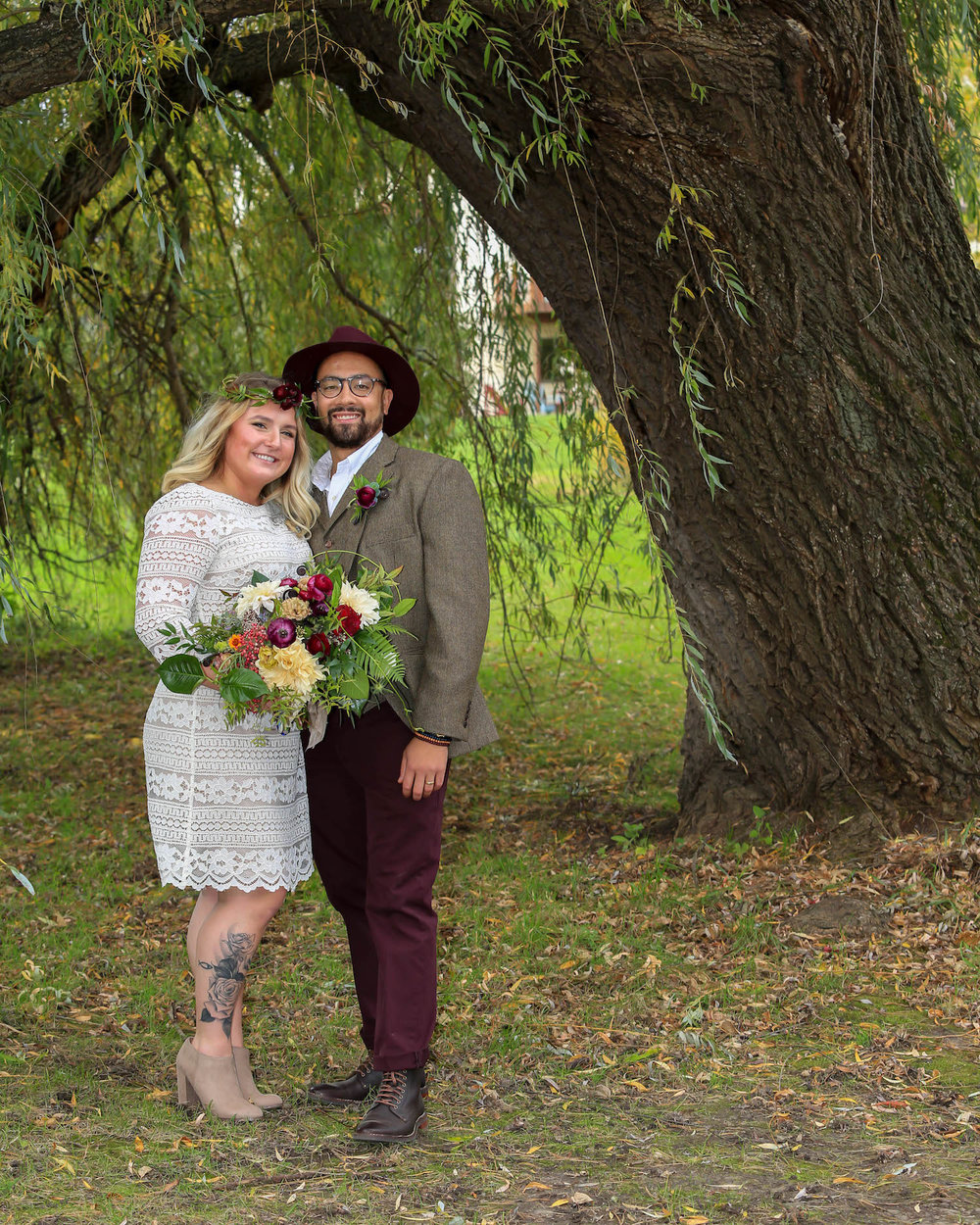 Cindyrella's Garden, outdoor ceremony on the lake in Minnesota, groom in a hat