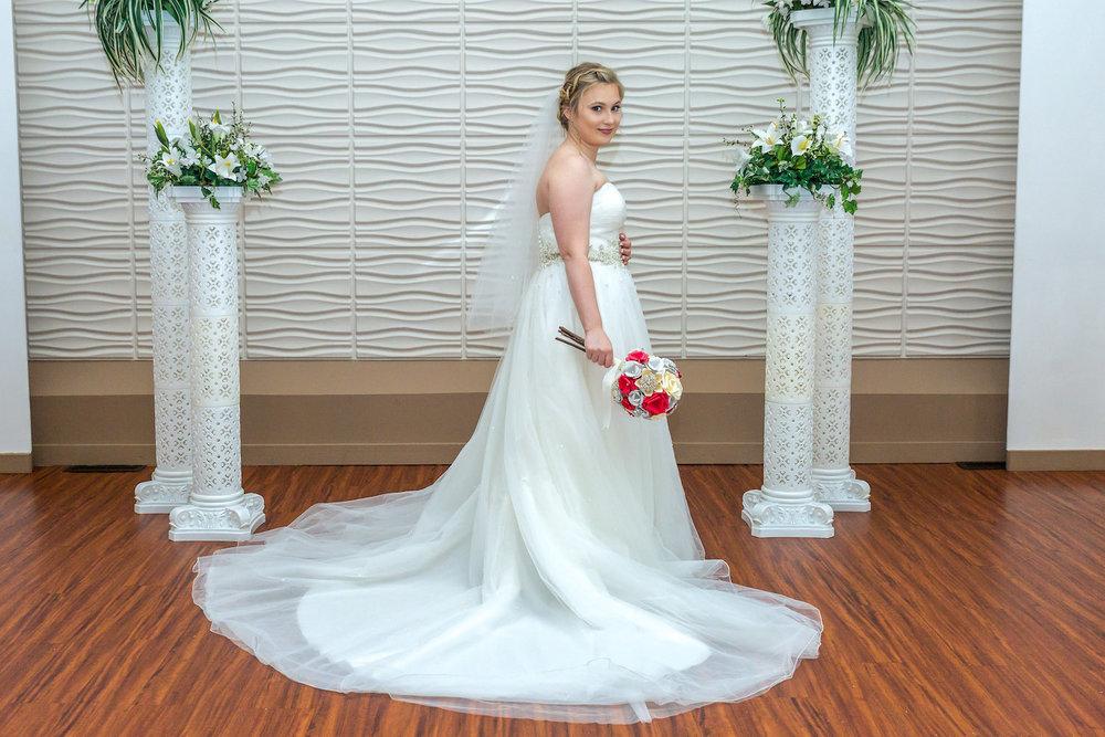 Rosehenge wedding, Lakeville wedding venue, affordable wedding venue in south Minnesota, bride in front of columns