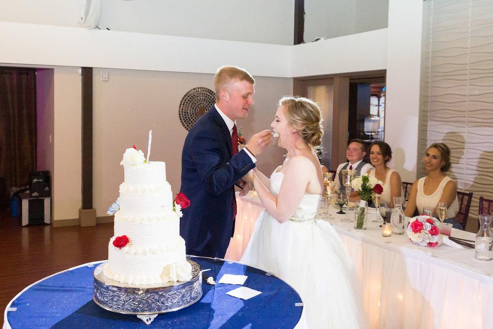 Rosehenge wedding, Lakeville wedding venue, affordable wedding venue in south Minnesota, feeding each other cake
