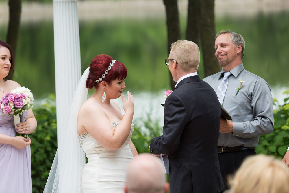 Cindyrella's Garden outdoor ceremony by the lake with a redhead bride, tears
