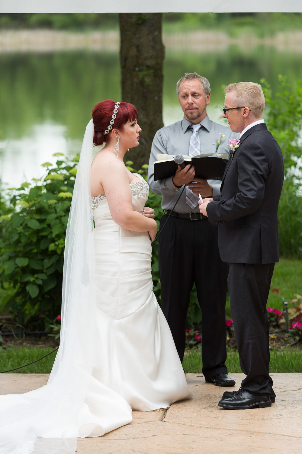 Cindyrella's Garden outdoor ceremony by the lake with a redhead bride, officiant