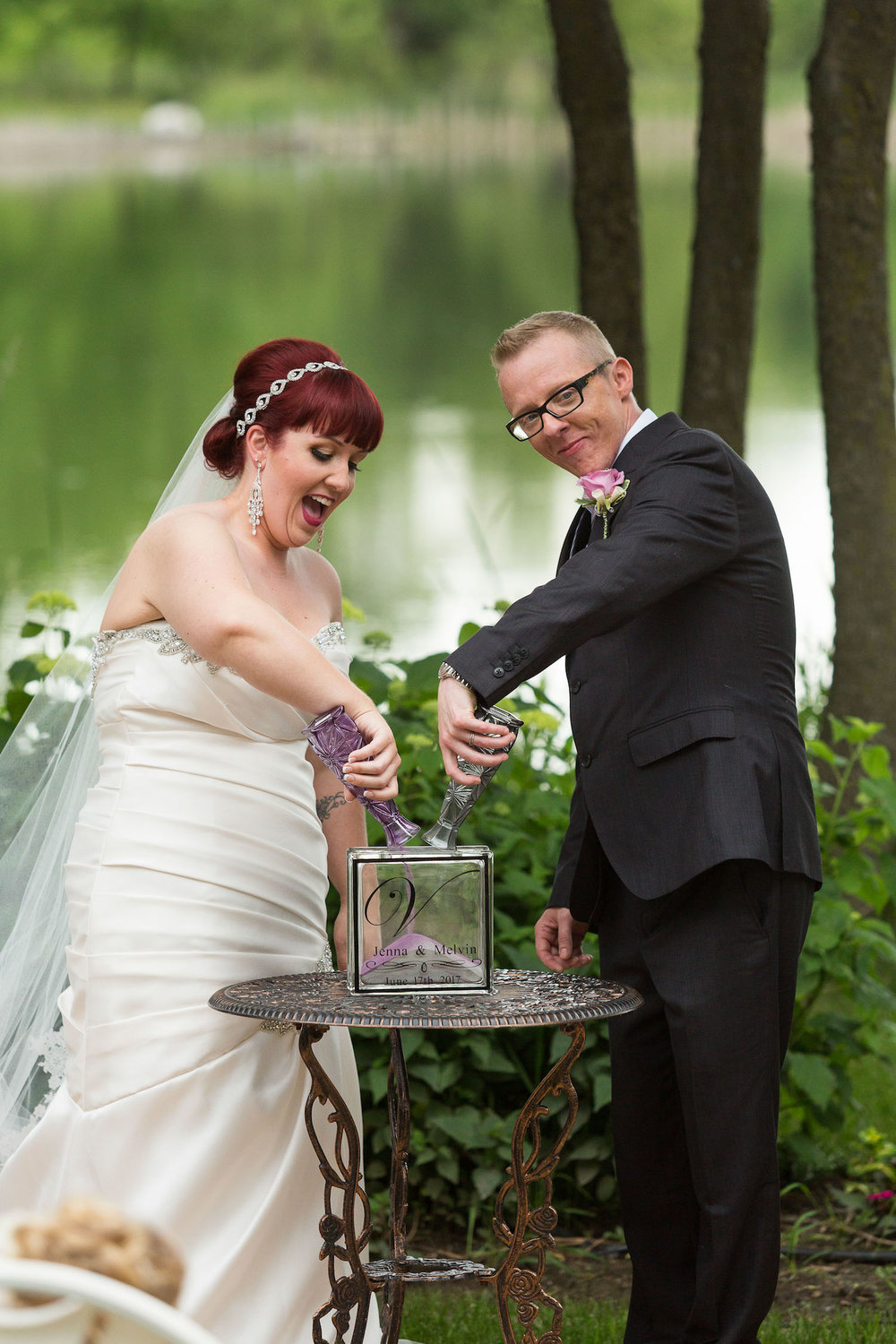 Cindyrella's Garden outdoor ceremony by the lake with a redhead bride, sand ceremony