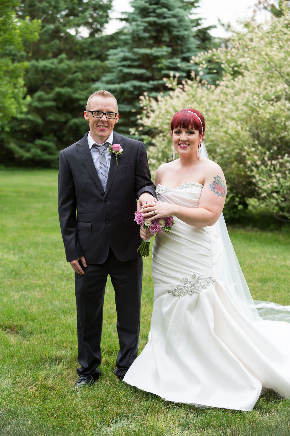 Cindyrella's Garden outdoor ceremony by the lake with a redhead bride, just married