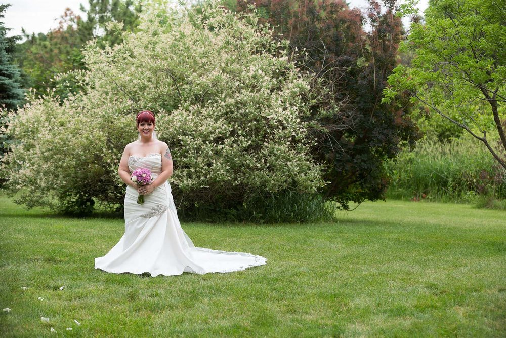 Cindyrella's Garden outdoor ceremony by the lake with a redhead bride, perfect train