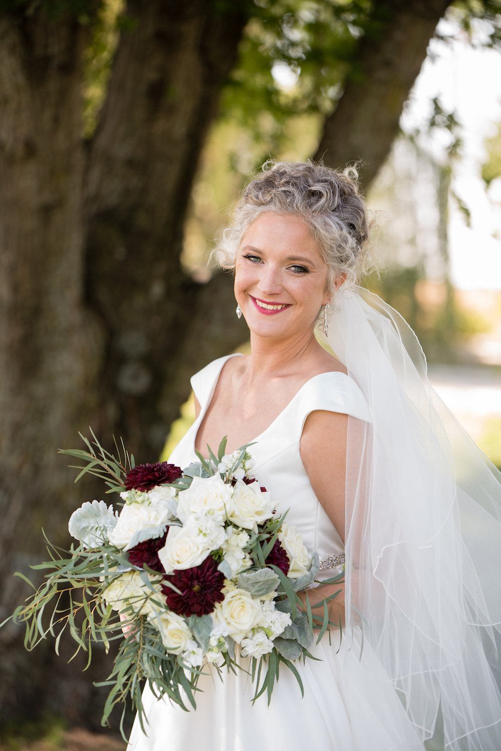Danielle Albrecht photographer at rustic Farmington lodge inspired wedding