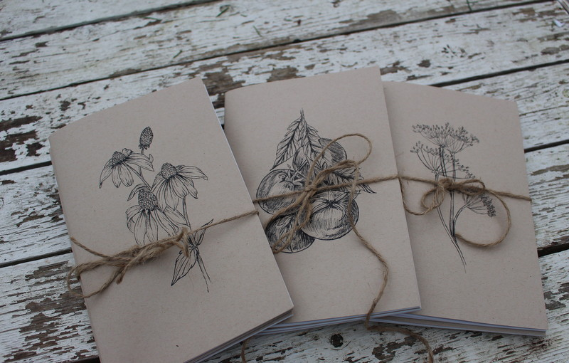 "Notebook Bundle  Three gorgeous notebooks with natural kraft paper covers, saddle stitch binding, and lovely artisan drawings of tomatoes, cow parsley, and coneflowers on the covers.  These booklets are perfect for us potager gardeners to plan, design, note, and paste pictures in. They measure 5.5""x8.5"" with 50 pages in each.  One booklet is graph paper, one is lined, and one is has blank paper for your sketches, drawings, and pictures.  The trio comes wrapped with jute twine and costs only $15. I am hoping that you love them as much as I do!"