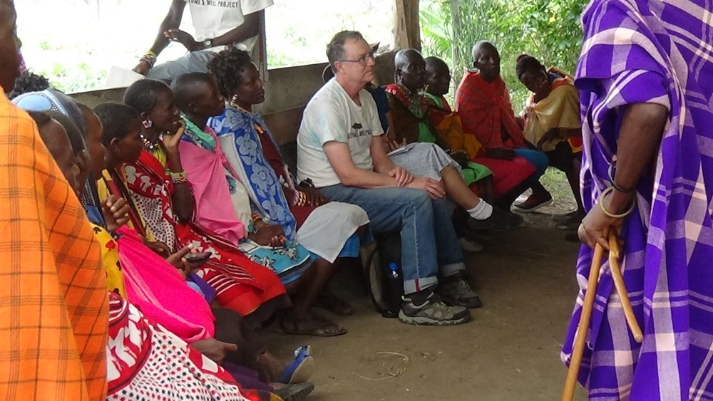 Dr. Groot joins members of the Maasai Mara Reserve at a community meeting.