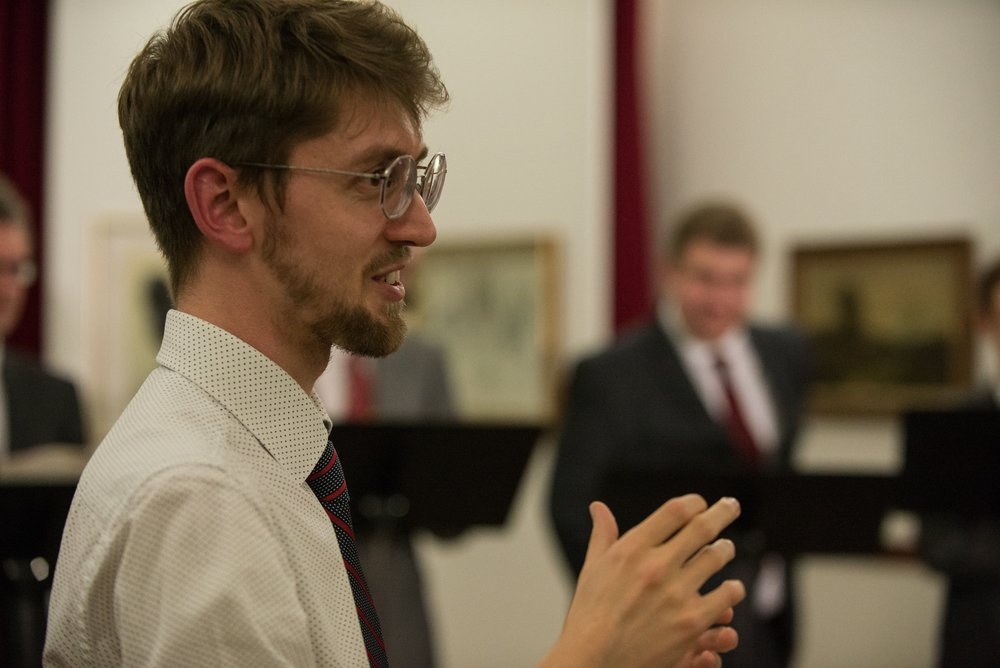Tomos Watkins - Conductor - Tomos Watkins is the conductor and artistic director of the Welsh Chamber Choir.
