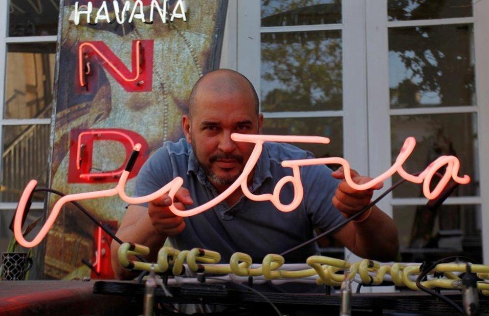 Kadir and sign.jpg