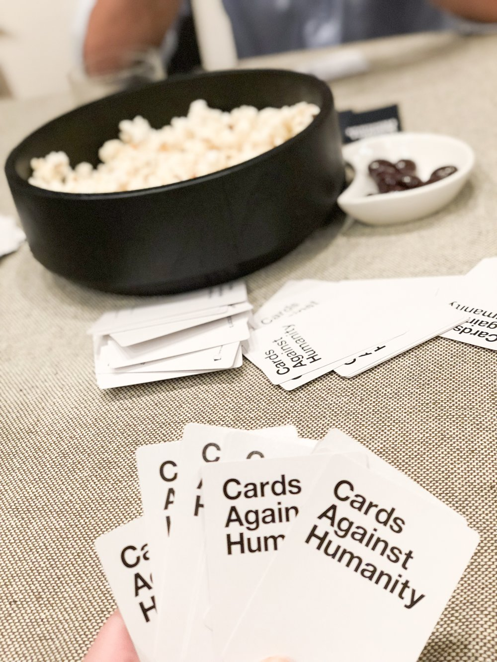 Our go to games lately have been Cards Against Humanity and Shifty Eye'd Spies. Thanks for reading, we hope you feel inspired to host your own game night!