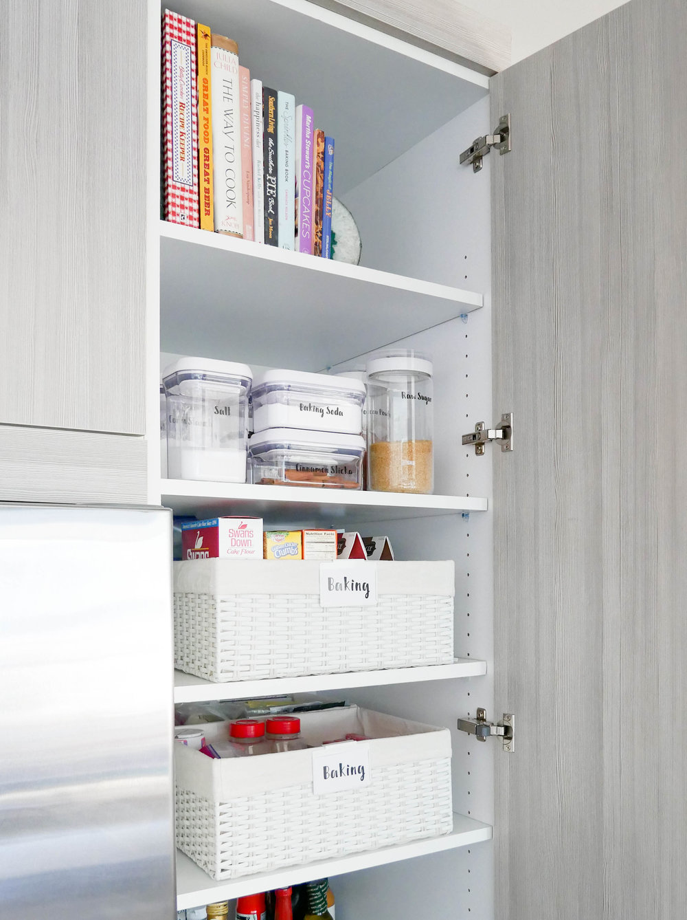 "Each organization project is custom to the individual client's wants, needs and lifestyle. Caitlin is an amazing baker so we made her baking supplies a priority in the ""valuable real estate"" a.k.a. the eye-level shelves."