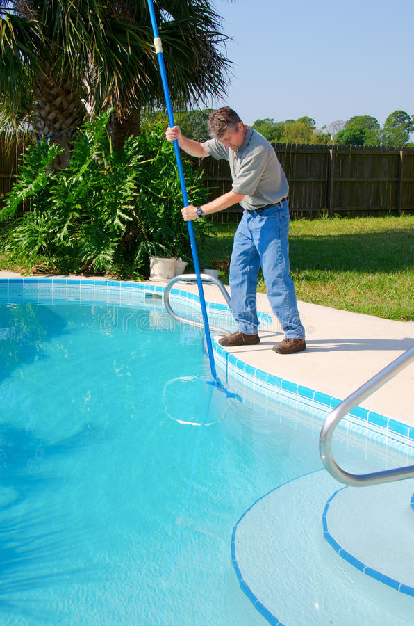 residential-pool-cleaning-service-man-working-sparkling-clean-pool-brushing-side-clean-30187412.jpg