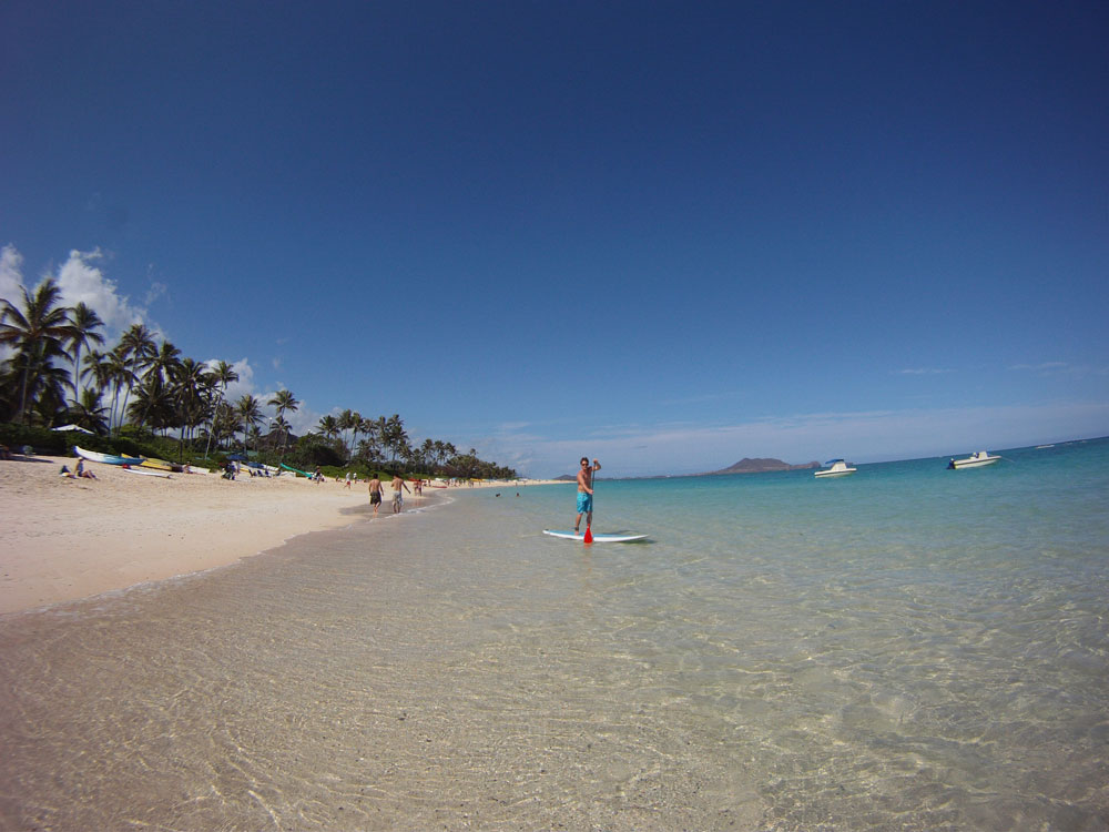 stand up paddler launching from Kailua Beach