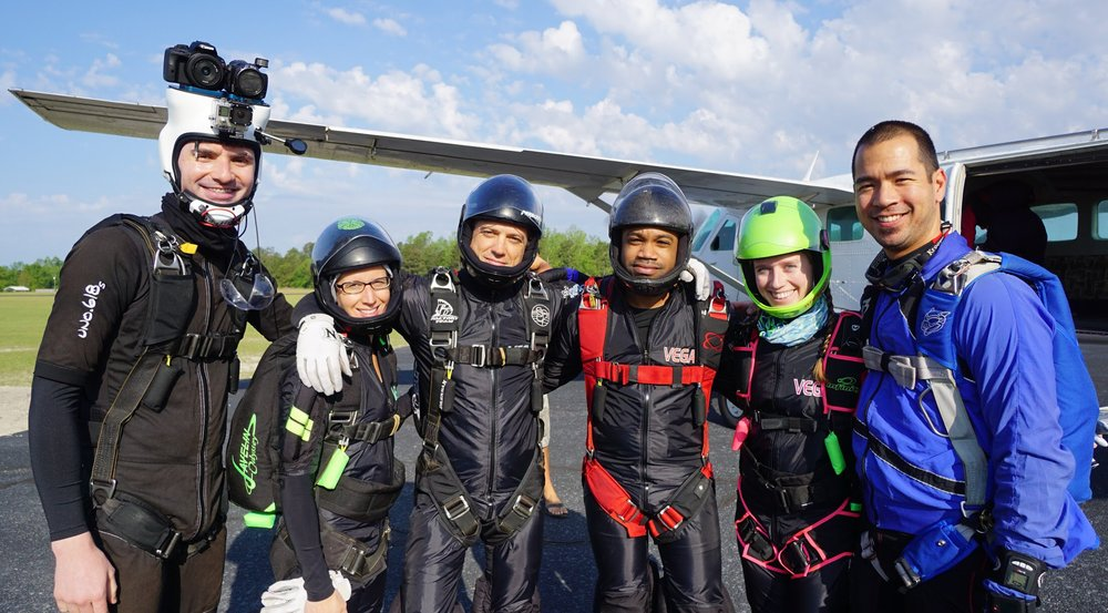 Nick (3rd from right) poses for a photo along with members of competitive skydiving team STF Vega.  Photo credit: Elliot Byrd