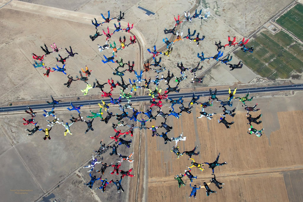 Photo of Michael and other skydivers participating in a successful world record jump at Skydive Perris.  Photo credit: Terry Clay Weatherford Photography