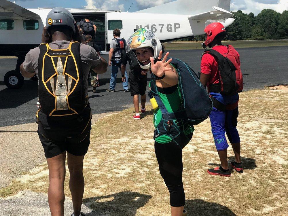 Nadia (center) boards the plane with Team Blackstar skydivers in North Carolina ( Photo credit: Danielle Williams)