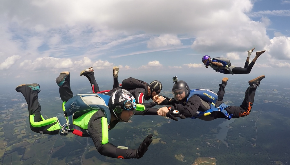 His favorite part of skydiving is the entire experience from sleeping outdoors and spending an entire day jumping with friends to sunset loads and Saturday night bonfires.  Photo courtesy of Nate Duborow.