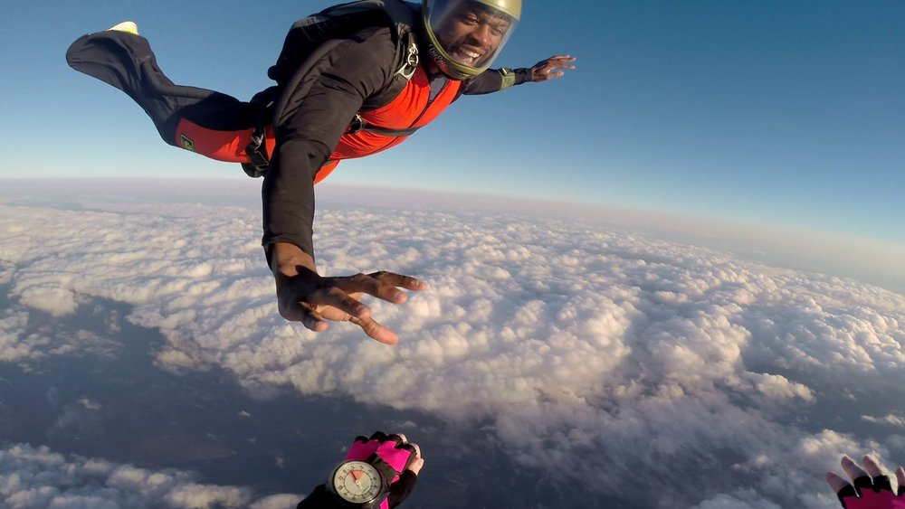 Manny reaches for a dock on a relative work skydive.  Photo courtesy of Melissa T