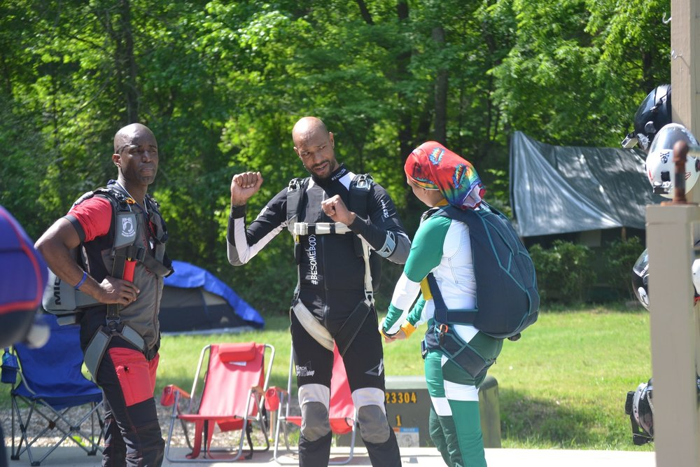 Waz Choudhry (center) reviews the dive plan with  Nadia Mercado .  Photo credit courtesy of Jackie Sylvester