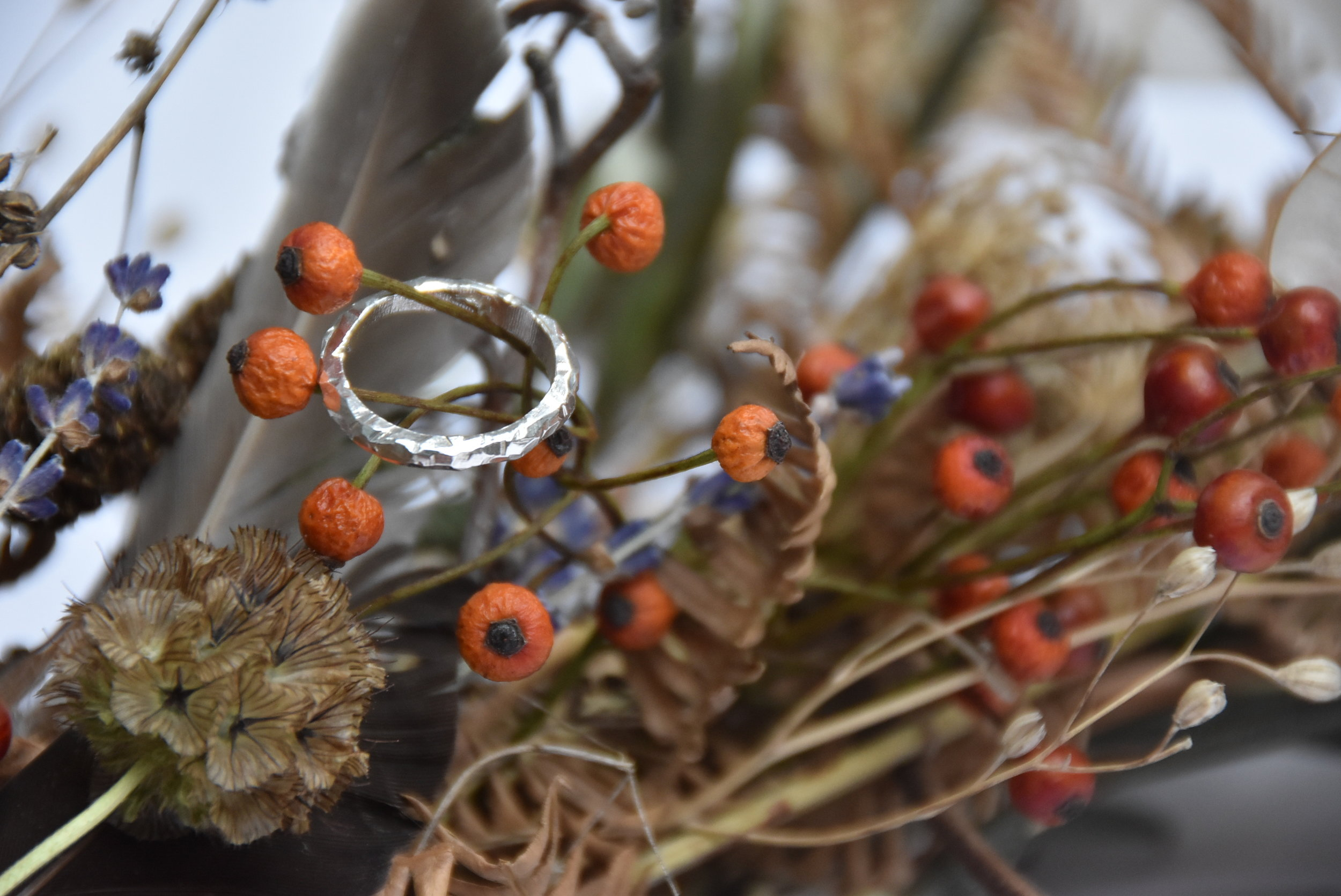 Handmade silver ring on winter wreath
