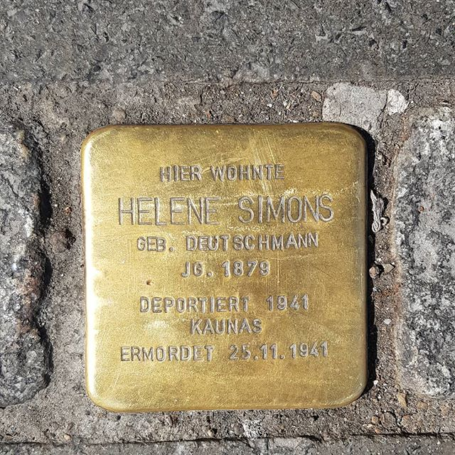 Stolpersteine - Stumbling blocks.  A project by artist Gunter Demnig.  This brass plate reminds passers by that a woman named Helene Simons lived here in Munich. She was deported and murdered by the Nazis.
