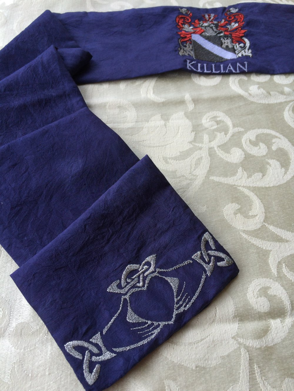 Custom-dyed blue silk cloth<br> with family crest.