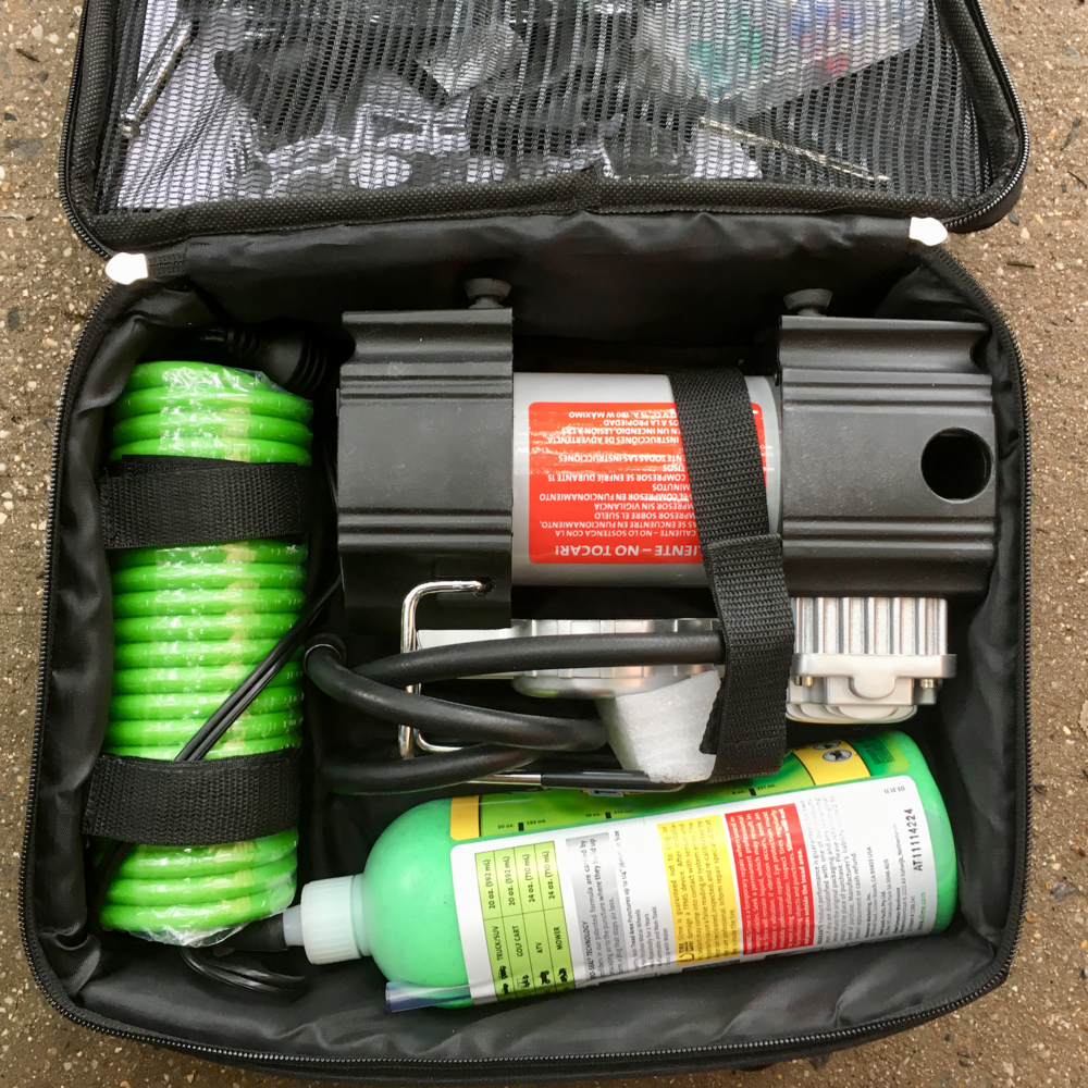 Justin's  Slime Inflator Kit , with  tire repair kit  stored in the top flap.