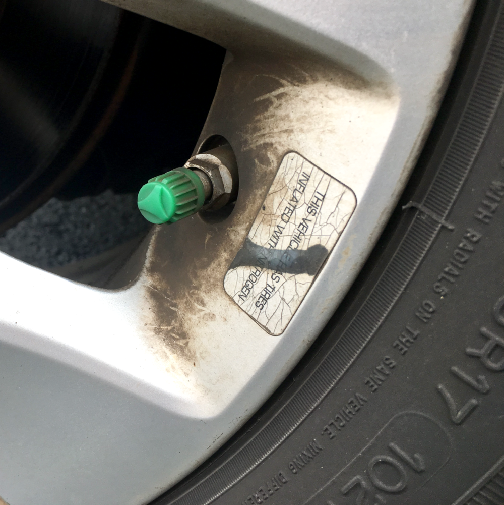 The green valve stem cover indicates this tire is filled with nitrogen rather than more common compressed air.