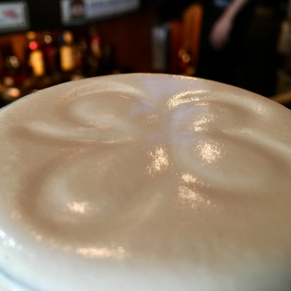 A dying art: drawing a shamrock in the head of a properly poured Guinness.