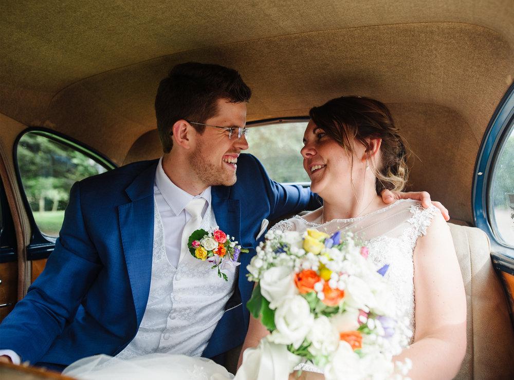 Hayden and Jess in their wedding car