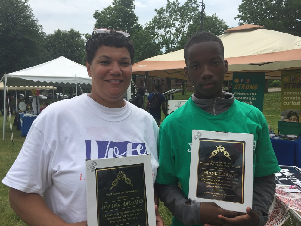 Lisa Neal-Delgado receives the Veterans Award at Juneteenth 2018, pictured with the awardee of the Young Professional Leader of the Year Frank Blount   Lisa served our country for almost 23 years!