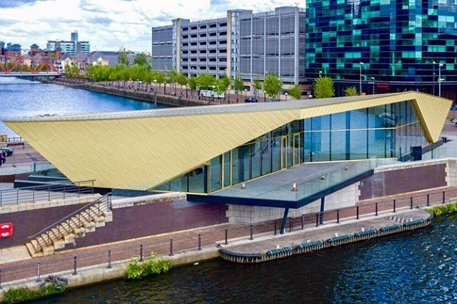 @reid_architects uses @elzinc Rainbow in a luxurious Gold to create a visual icon in MediaCity, UK • • • The Alchemist is stunning inside and out. Visit the link in our bio for more projects! #facadelovers #architecture #exteriors #thealchemist #manchester #buildingmaterial