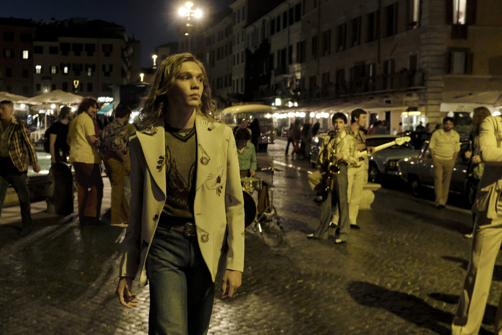 Charlie Plummer walking around the streets of Rome in the first scene