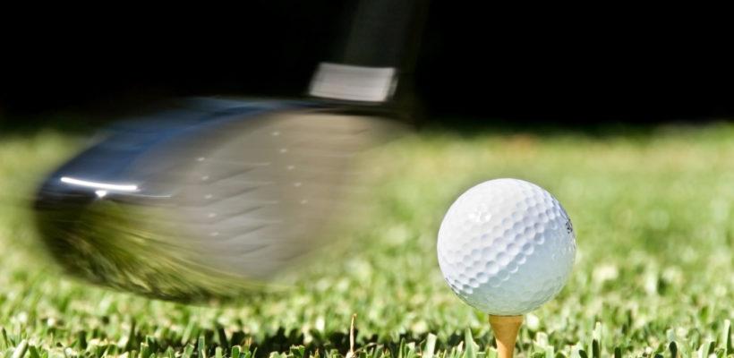 Driver hitting a Golf Ball