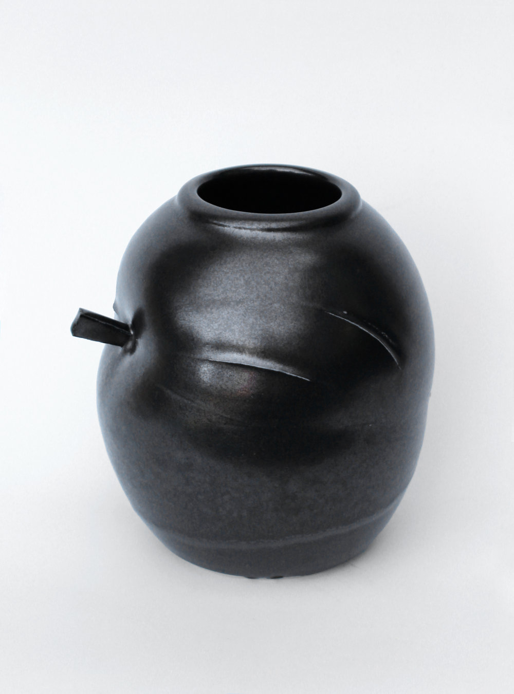 small_black_string_pot.jpg