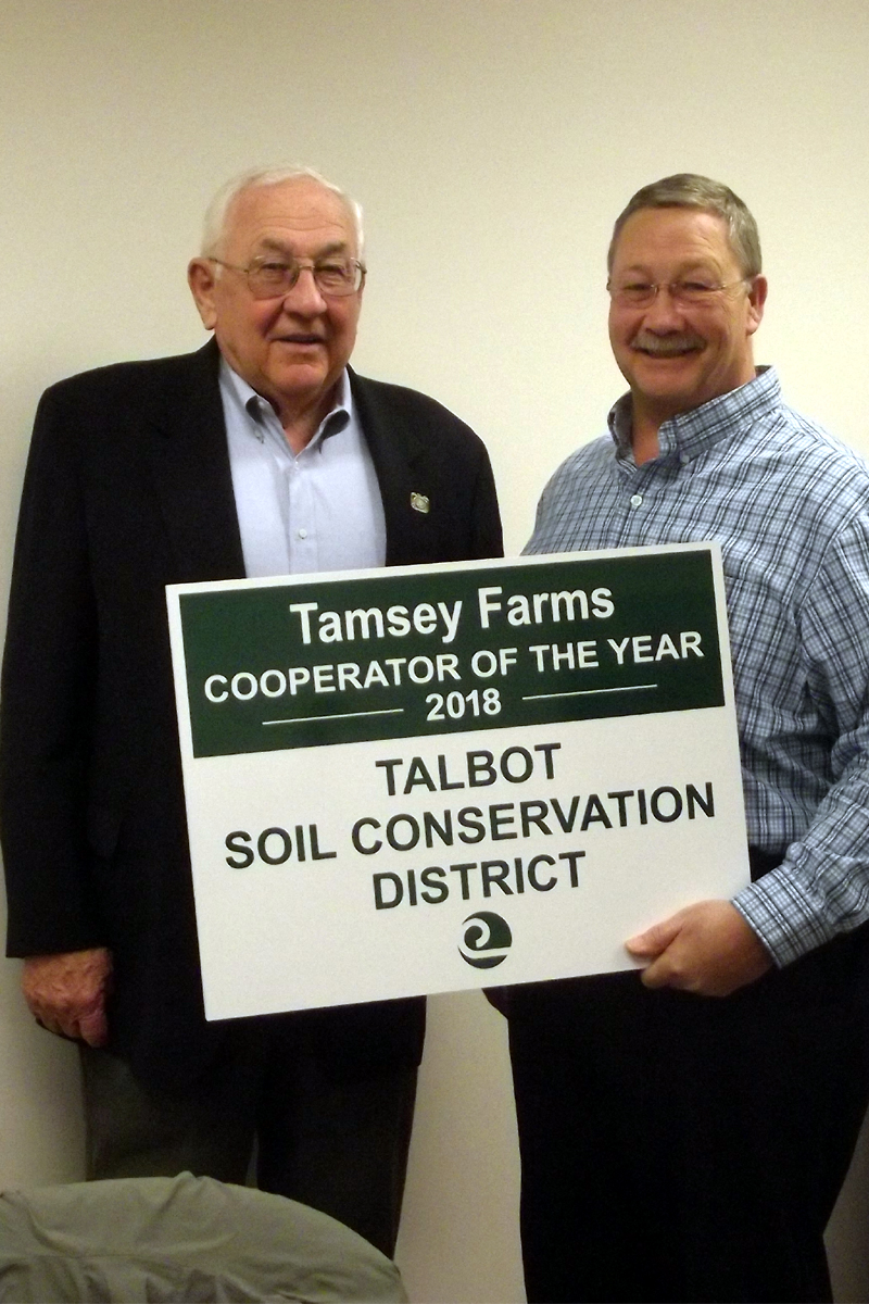 Mr. George Brennan of Tamsey Farms with Craig Zinter, District Manager