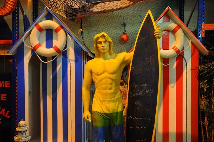 Beach Huts and Surfer Chalk Board