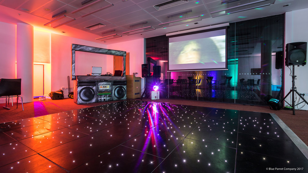 LED dancefloor and cassette player DJ booth