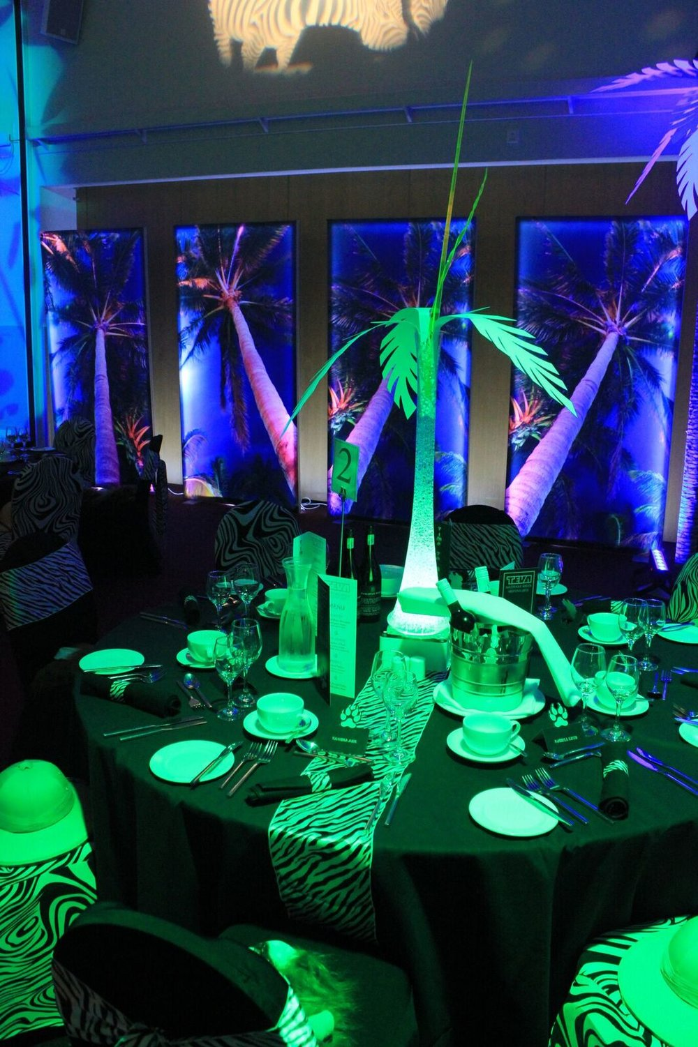 Jungle themed table decor and palm tree light panels