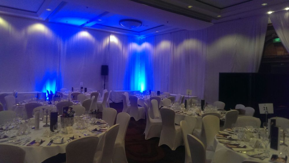 white drapes with uplighters.JPG