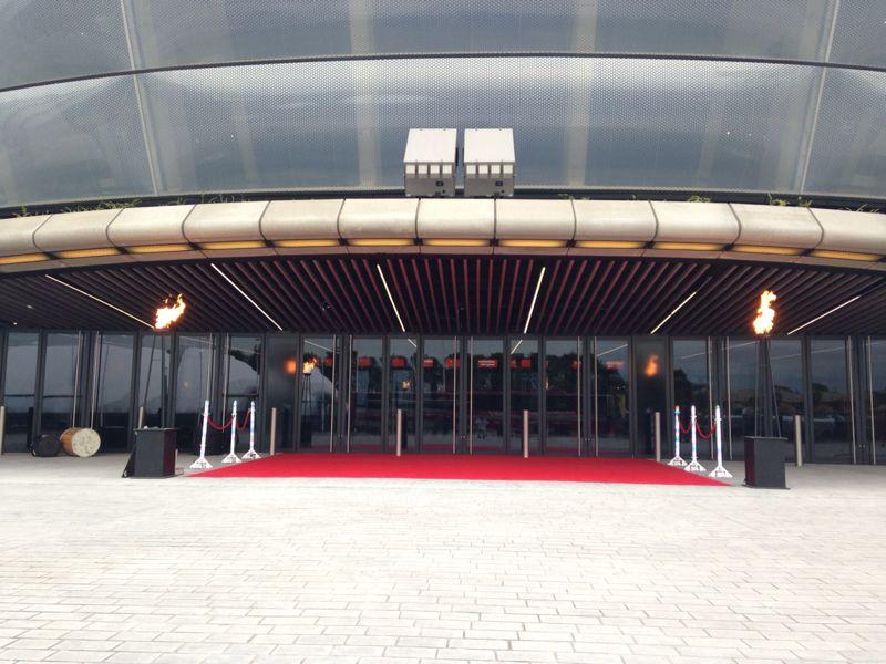 Red carpet entrance flambeaux.jpg