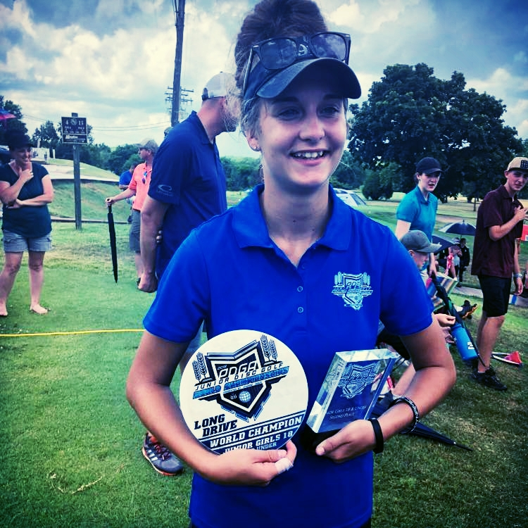 Kat Mertsch -  PDGA 99455 Currently ranked Number 2 in the World in the FJ18 Division,Kat's showing at the 2018 Junior World Championships in Emporia, Kansas, was a lesson in patience, focus, and determination. She is one of a select group of women under the age of 18 who consistently and skillfully play World Class Disc Golf. We see a World Title in her very near future.
