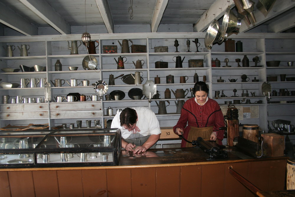 Interpreters in the Tinsmith Shop.
