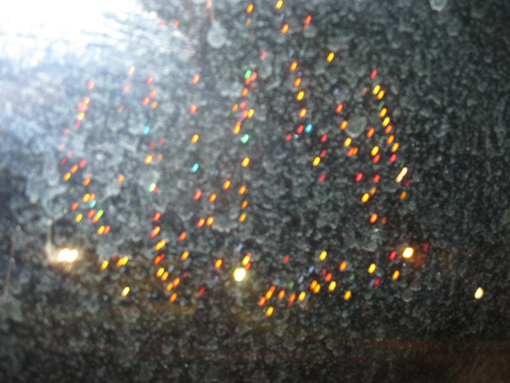 Dancing lights on windshield (photo).JPG
