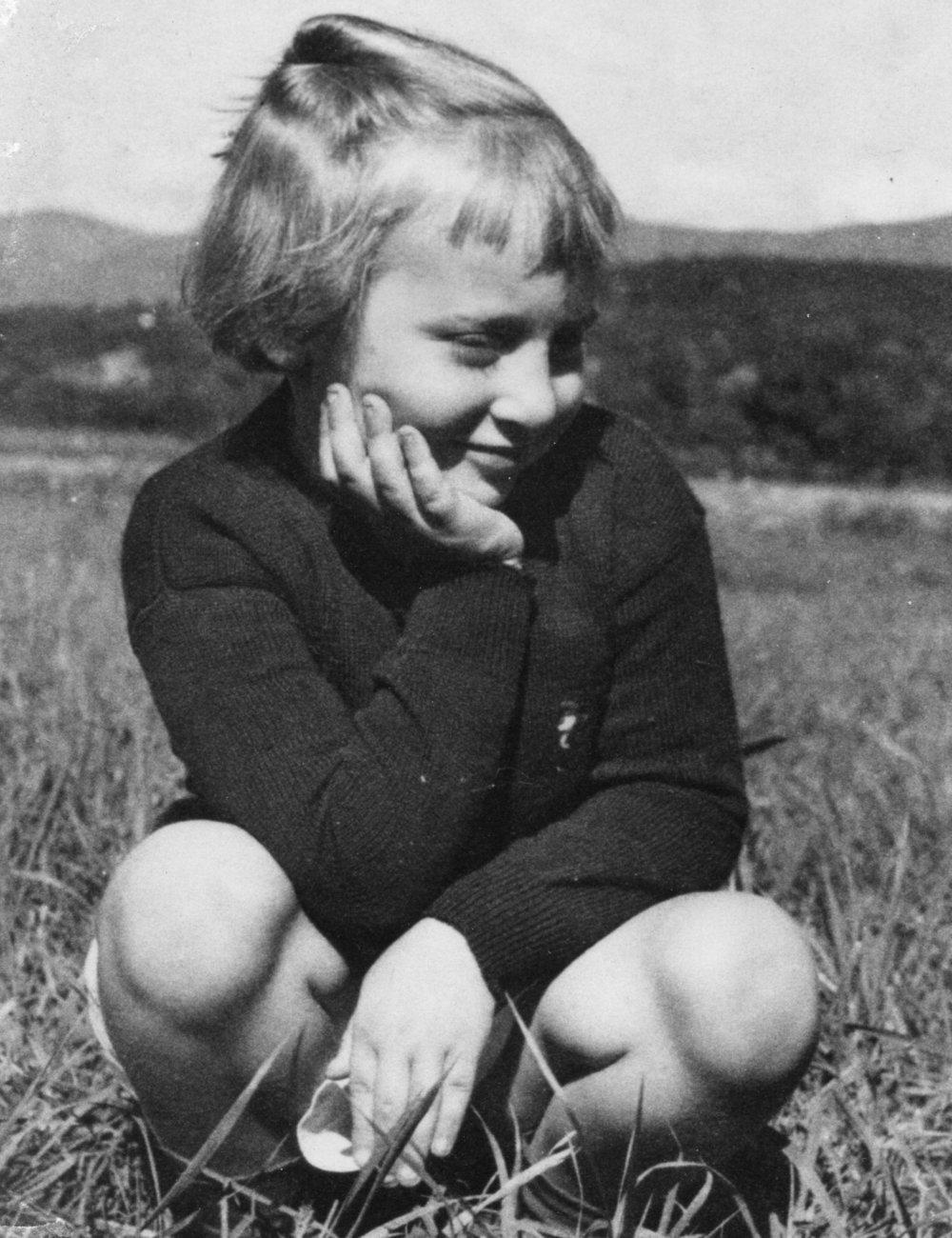 Naomi Rose as a contemplative child in nature