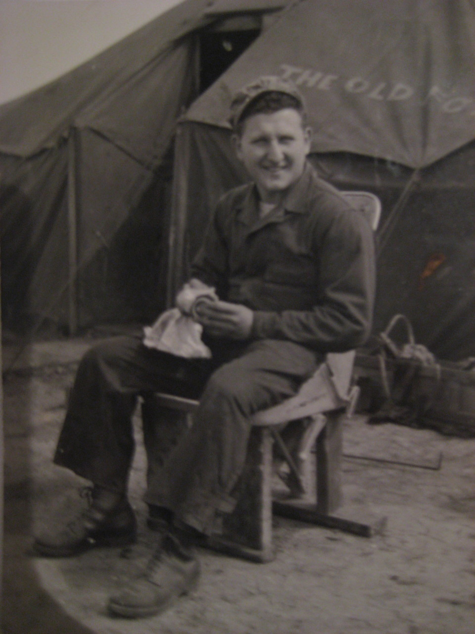 "On the tent behind my grandpa, it says ""The Old Fox.""   From May, 1944, in England.   On the back of the photo, it says,  working hard ."