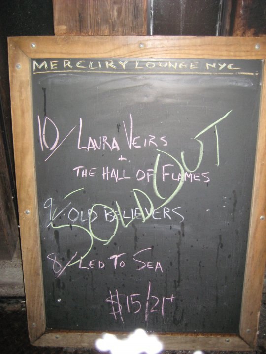 I saw Laura Veirs and her band play last night. Lance walked me to the Mercury Lounge, then surprised me with tickets for my birthday. I was so excited, I could've kissed the bouncer.   But I didn't. Cause I've already done that too much in internet videos.   Anyway, Laura's show made me remember why I love songs and the world and violins and unpretentious, hard-working, warm-hearted people who tell brief, self-deprecating stories and then play really beautiful music.    Also, Laura is seven months pregnant.